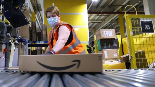 """US tech giant Amazon is to go on a hiring spree in the UK as online shopping continues to boom in the pandemic.  Amazon is to hire 10,000 UK employees as it opens more warehouses in the north and south of England.  It is also creating a number of corporate roles in Cambridge, Edinburgh, London and Manchester.  Business Secretary Kwasi Kwarteng said the move was """"a huge vote of confidence in the British economy"""".  The coronavirus pandemic has accelerated a trend towards online shopping, and tech giants such as Amazon have reaped the benefits.  Now the firm, which has come under criticism over working conditions and over the amount of tax it pays, is further entrenching its position in the UK. The addition of 10,000 new roles, including thousands in its warehouses, will take its UK workforce to more than 55,000 by the end of the year.  Amazon said pay for operations roles was £9.70 per hour, or £10.80 in London, with other benefits.  Its profits tripled in the first three months of the year to $8.1bn (£5.76bn), up from $2.5bn a year ago.  The online retail giant will open new """"fulfilment"""" warehouses in Dartford, Gateshead, Hinckley and Swindon, and a """"parcel receive"""" warehouse in Doncaster.  It will recruit in its offices for roles in fashion, digital marketing, engineering, video production, software development, cloud computing, AI and machine learning.  The company will also be recruiting for its Amazon Web Services (AWS) cloud computing business and its operations network.  Working conditions Amazon continues to face scrutiny over how much tax it pays in the UK, which prompted the government to launch a digital services tax in April 2020.  The online retail giant has insisted that it pays all taxes required in the UK.  On Thursday, it won a court battle overturning an order for it to pay €250m (£215m) in back taxes to the EU.  In March, the Unite union demanded that Amazon give its British workers a """"new deal"""", including allowing them to unionise and have a greate"""